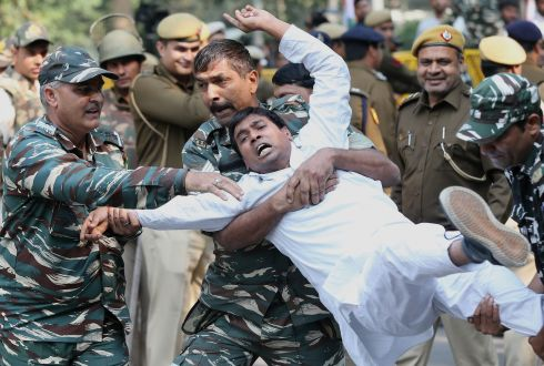 DELHI PROTESTS: Security personnel detain an Indian Youth Congress activist during a demonstration in New Delhi, India. Hundreds protested after the Indian government downgraded the Gandhi family's security cover. Photograph: Harish Tyagiepa/EPA