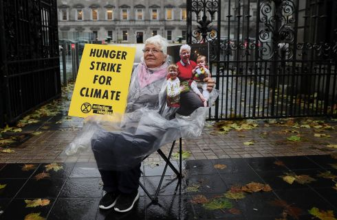 SEPTUAGENARIAN STRIKER: Patricia Devlin (78), a member of Extinction Rebellion Ireland, holds a photograph of her grandchildren, Ollie Doyle (4) and Liam Doyle (11 months), as she commences a hunger strike outside the gates of Leinster House, Dublin, to highlight climate change. Photograph: Brian Lawless/PA Wire