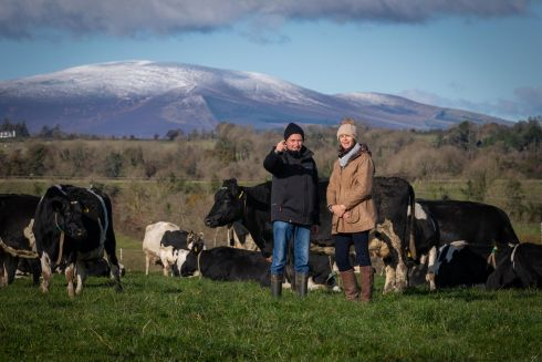 FIELD VISIT:  Kieran Hearne with Zoe Kavanagh, chief executive of the National Dairy Council, who visited his dairy farm in Rathgormack, Co Waterford to highlight the changes taking place in farming practices. Photograph: Dylan Vaughan