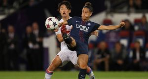Saki Kumagai of Olympique Lyonnais and Veronica Boquete of PSG in action. Vero moved to PSG after criticising the conditions  of the women's game in Spain. Photograph:   Matthew Ashton/AMA/Getty Images