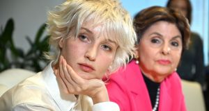 'Jane Doe 15' (L) who accuses late Jeffrey Epstein of sexually abusing her when she was 15 years old, holds a press conference at the office of her attorney Gloria Allred (R) on November Monday. Photograph: Robyn Beck/AFP