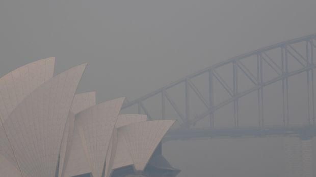 Thick smoke hangs in the sky in Sydney on Thursday. The smoke comes from the Gospers Mountain fire north west of Sydney, which has been burning for over a week now, and has burnt more than 160,000 hectares of land. Photograph: Dean Lewins/EPA