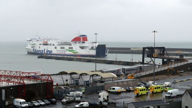 The ferry on which 16 people were found arrives at Rosslare Europort in Co Wexford, where emergency personnel await its arrival. Photograph: Niall Carson/PA Wire.