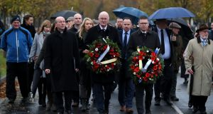 GAA president John Horan (centre) and director general Tom Ryan  with wreaths  at Glasnevin Cemetery where the GAA unveiled  headstones for  three  victims of the Bloody Sunday shootings.  Photograph: Brian Lawless/PA Wire