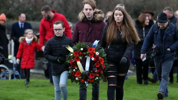 Cousins Sean Strutt (10), Mark Feery (18) and Sophie Feery (18), great great grandchildren of Bloody Sunday victim Michael Feery. Photograph: Brian Lawless/PA Wire
