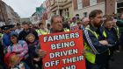 "Farmers protesting outside the Dáil. The  IFA  has accused the Sustainability Energy Authority of Ireland of  ""straying outside its remit"". Photograph: Alan Betson"