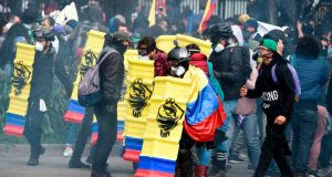 COLOMBIA: Demonstrators clash with riot police in Bogota, on November 21st during a nationwide strike called by students, unions and indigenous groups to protest against the government of president Ivan Duque. Photograph: Juan Barreto/AFP via Getty