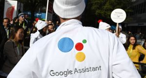 "Attendees wait to ask a question of a Google Assistant at a giant ""Hey Google"" gumball machine game at CES 2019 at the Las Vegas Convention Center in Las Vegas, Nevada. Photograph: Robyn Beck / AFP"