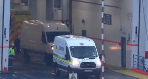 Garda at Rosslare Europort in Co Wexford, onboard a Stena Line ferry after 16 people were discovered in a sealed trailer on the ship sailing from France. Photograph: Niall Carson/PA