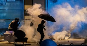 Protesters surrounded by tear gas near the Hong Kong Polytechnic University, on Monday. Photograph: Lam Yik Fei/The New York Times