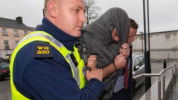 John Joyce (centre, wearing grey hoodie)pictured arriving at Mullingar District Court. Photograph: Colin Keegan, Collins Dublin