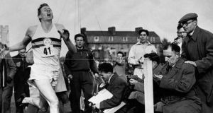 Roger Bannister becoming the first man to run the mile in under four minutes in Oxfordshire, England, on May  6th, 1954.   Photograph:  Bentley Archive/Popperfoto via Getty Images