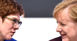 Party chairwoman Annegret Kramp-Karrenbauer and chancellor Angela Merkel  at the CDU party congress in Leipzig: AKK believes  Germany has been treading water for too long. Photograph: Matthias Rietschel