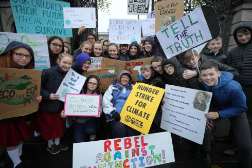 FRIDAYS FOR FUTURE: Striking schoolchildren stand with Patricia Devlin (78) of Extinction Rebellion Ireland, who is continuing her hunger strike outside Dáil Eireann to highlight the climate emergency. Together they are calling on the Government to reduce Ireland's carbon emissions to net zero by 2030. Photograph: Nick Bradshaw