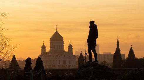 SLAVIC SUNSET: A man stands in front of the Kremlin and the Cathedral of Christ the Saviour during sunset in Moscow, Russia. Photograph: Sergei Ilnitsky/EPA