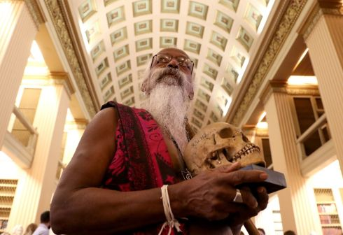RETURNING HOME: Wanniya Uruwarige, chief of the Sri Lankan Vedda tribe people, holds one of nine human skulls thought to be more than 200 years old, after a ceremony in the University of Edinburgh's Playfair Library to mark the return of the ancestral remains to the tribe's homeland. Photograph: Andrew Milligan/PA Wire