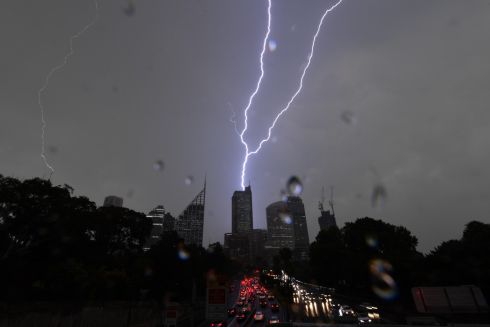 LIGHTNING DOWN UNDER: Wet and stormy weather is seen around the central business district in Sydney, Australia. Photograph: Dean Lewins/EPA