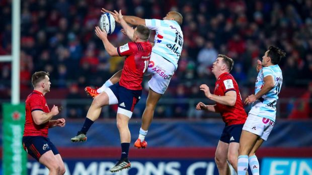 Munster's Andrew Conway competes for the ball with Racing 92's Simon Zebo of Racing 92 during the Heineken Champions Cup game at Thomond park. Photograph: Tommy Dickson/Inpho