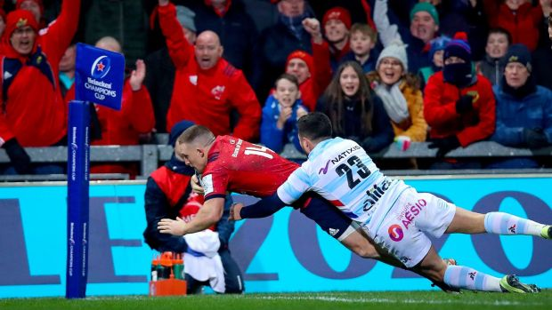 Munster's Andrew Conway scores a try during the Heineken Champions Cup game against Racing 92 at Thomond park. Photograph: Tommy Dickson/Inpho