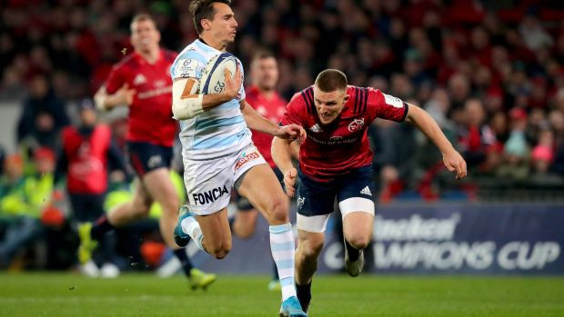 Racing 92's Juan Imhoff scores his side's third try of the game despite the attempts of Munster's Andrew Conway during the Heineken Champions Cup match at Thomond Park. Photograph: Ryan Byrne/Inpho