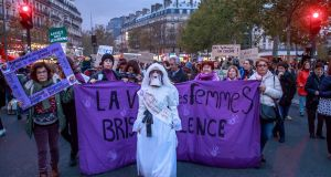 Women's rights activists hold placards with purple signs of  feminist movement Nous Toutes (All of Us) as they march during a rally against femicide, gender-based violence and sexual harassment against women, in Paris, France, on Saturday. Photograph: Christophe Petit Tesson/EPA
