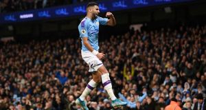Riyad Mahrez  celebrates after scoring Manchester City's second goal during the Premier League match against  Chelsea  at Etihad stadium. Photograph: Laurence Griffiths/Getty Images