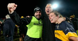 Mourneabbey's manager Shane Roynane and Niamh O'Sullivan celebrate with supporters at the final whistle. Photograph: Lorraine O'Sullivan/Inpho