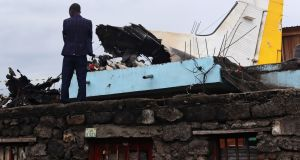 A man stands at the site where a plane crashed into a densely populated neighborhood in Goma, eastern Democratic Republic of Congo on Sunday. Photograph: Reuters