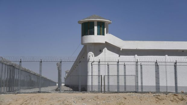 A watchtower near what is believed to be a re-education camp where Muslim ethnic minorities are detained, on the outskirts of Hotan, in China's northwestern Xinjiang region. Photograph: Greg Baker/AFP