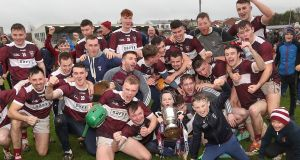 Borris Ileigh's players celebrate after the game with the Munster club hurling trophy. Photograph: Bryan Keane/Inpho