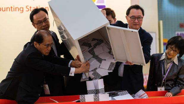 A ballot box is emptied at a polling station in Hong Kong as anti-government protests continue into their sixth month. Photograph: Billy HC Kwok/Getty
