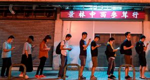 People queue to cast their vote during the district council elections in Tseung Kwan O district in Hong Kong. Photograph: Ye Aung Thu/AFP