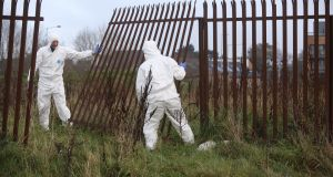 Garda forensic experts at the scene in Ballymun where the body was found.  Photograph: Collins
