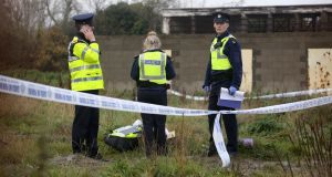 Gardaí pictured at the scene where  a body was found in the Balbutcher Lane area of Ballymun on Monday.  Photograph: Collins