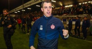Shelbourne manager Ian Morris celebrates his side's promotion to the Premier Division. Photograph: Ryan Byrne/Inpho