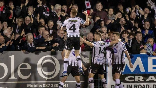 Dundalk's Michael Duffy celebrates scoring his side's third goal against Shamrock Rovers at Oriel Park in September. Photograph: Morgan Treacy/Inpho