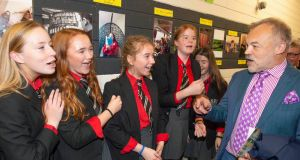 Graham Norton with students from Bandon Grammar School, where he launched a new history of the school by principal Ian Coombes. Photograph: Michael Mac Sweeney/Provision