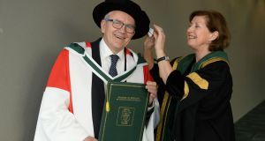 Irish Times education columnist Brian Mooney receiving an honorary degree from the National University of Ireland,  pictured with NUI registrar Dr Attracta Halpin. Photograph: Dara Mac Dónaill