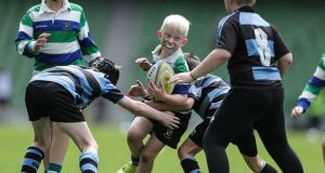 "A mini-rugby festival at the Aviva: Children play rugby at clubs and at school, but many drop out when they move from primary to second level and when they leave second level school,"" says the report. Photograph: Laszlo Geczo/Inpho"