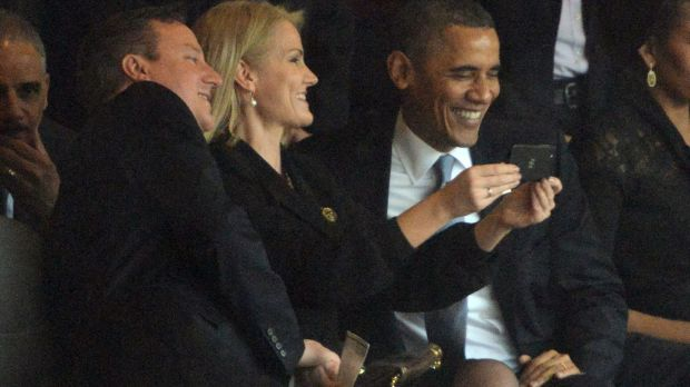 Former US president Barack Obama (R) and former British prime minister David Cameron pose for a selfie picture with Denmark's former prime minister Helle Thorning Schmidt (C) during the memorial service of South African former president Nelson Mandela. Photograph: Roberto Schmidt/AFP via Getty