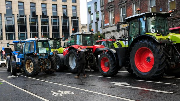 Farmers and tractors block St Stephen's Green, Dublin. Photograph: Collins
