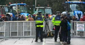 Gardaí behind a barricade at Stephens Green, Dublin during a protest by farmers over farm produce prices on Wednesday. Photograph: Collins