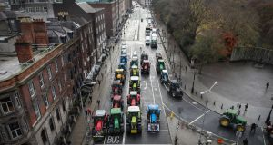 Tractors parked around St Stephen's Green during the second day of a protest by farmers. Photograph: Crispin Rodwell/The Irish Times