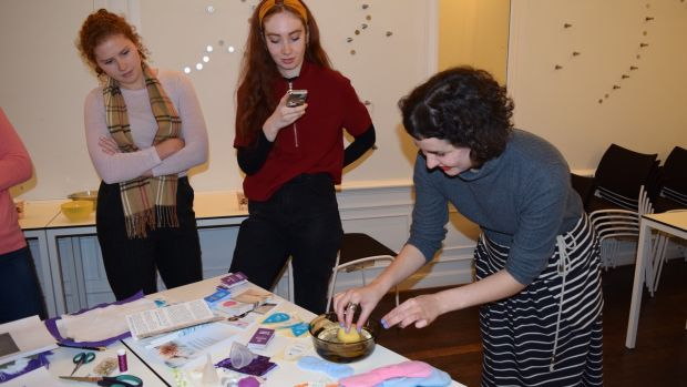 Charlotte Amrouche demonstrating alternative menstrual products at a Míosta workshop in UCD.