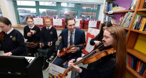 Minister for Health Simon Harris TD, gets a quick music lesson from  students during the launch of 'Know the Score' – a new educational resource on drugs and alcohol for senior cycle students, at Rosary College,  Crumlin. Photograph: Alan Betson