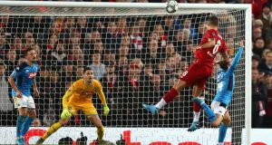 Dejan Lovren heads home Liverpool's equaliser  during the  Champions League Group E match against Napoli  at Anfield. Photograph: Michael Steele/Getty Images