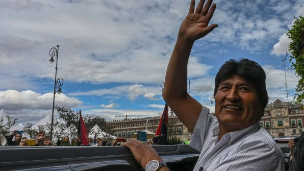 Former Bolivian president Evo Morales waves during a November visit to Mexico City. Photograph: Pedro Pardo/AFP via Getty Images