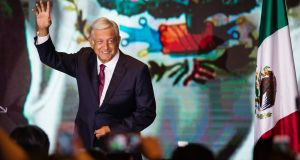 Andrés Manuel López Obrador salutes attendants after the elections for the presidency of Mexico in the Media Center at the Hilton Hotel in Mexico City in July 2018. Photograph: Getty Images