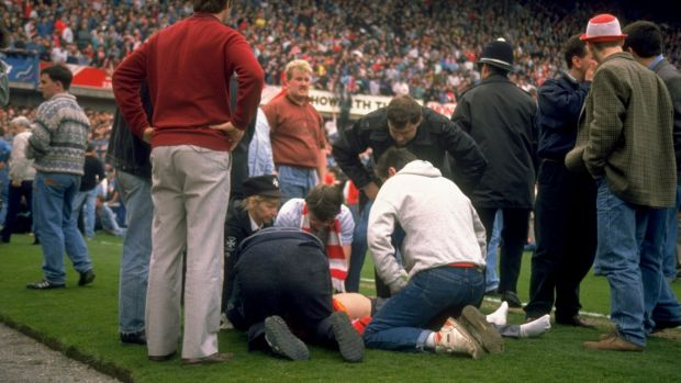 Supporters on the pitch after the FA Cup semi-final match between Liverpool and Nottingham Forest at Hillsborough in 1989. Photograph: David Cannon/Allsport