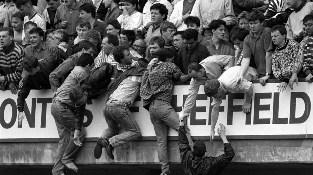 Liverpool fans trying to escape severe overcrowding during the 1989 FA Cup semi-final. Photograph: David Giles/PA Wire